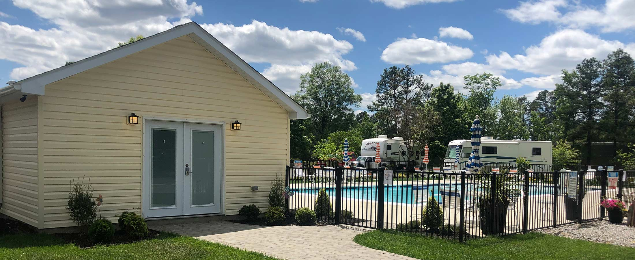 yellow office building by pool with rvs